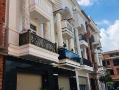 Nhà phố 4 tầng, 90m2,  sổ hồng riêng, đường 8m thông, đối diện chợ, ảnh thật