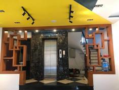 Nhà Đội Cấn, Ba đình 60m x 7 tầng, thang máy nhập, 2 mặt thoáng, gara ôtô, kinh doanh tốt